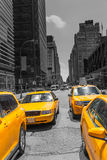Times Square New York yellow cab daylight Stock Image