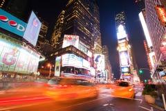 Times Square at night. NEW YORK CITY, NY - OCTOBER 20: Taxis in motion on Times Square on October 20, 2010 in Manhattan, New York city royalty free stock photo