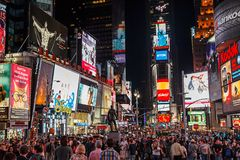 Times square at night. NEW YORK - APRIL 17, 2012: Night traffic across Times square on April 17, 2012 in New York City. Times Square is the most visited tourist Stock Image