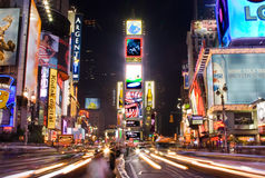 Times Square by night. Night scene of Times Square in Manhattan (New York City) with all the lit up billboards and advertisements royalty free stock images