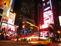 Times Square by night. Taxi whizzing past north side of Times Square, New York stock photo