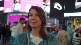 Times square at night. Young woman walking stock video