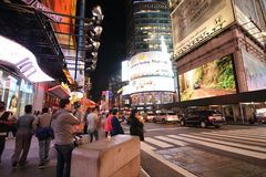 Times Square Nighttime Scene, Manhattan. People and cars on 42nd Street near Times Square looking at Neon Signs and Digital Billboards royalty free stock photos