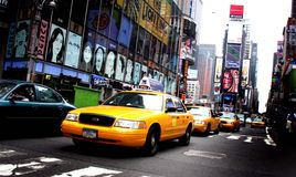 Times Square NYC. Taxis driving through Times Square in NYC stock image