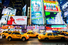 Times Square NYC. Times Square billboards, New York City and yellow taxicabs.  February 2012.  NYC Stock Image