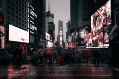 Times Square in NYC. NEW YORK, USA - Apr 30, 2016: Times Square in the rainy evening. Brightly adorned with billboards and advertisements, Times Square is royalty free stock images