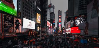 Times Square in NYC. NEW YORK, USA - Apr 30, 2016: Times Square in the rainy evening. Brightly adorned with billboards and advertisements, Times Square is stock images