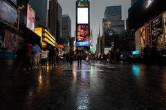 Times Square in NYC. NEW YORK, USA - Apr 30, 2016: Times Square in the rainy evening. Brightly adorned with billboards and advertisements, Times Square is stock image