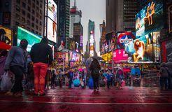 Times Square in NYC. NEW YORK, USA - Apr 30, 2016: Times Square in the rainy evening. Brightly adorned with billboards and advertisements, Times Square is stock photography