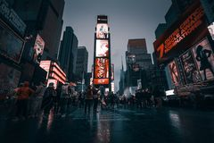 Times Square in NYC. NEW YORK, USA - Apr 30, 2016: Times Square in the rainy evening. Brightly adorned with billboards and advertisements, Times Square is stock photos