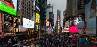 Times Square in NYC. NEW YORK, USA - Apr 30, 2016: Times Square in the rainy evening. Brightly adorned with billboards and advertisements, Times Square is stock photo