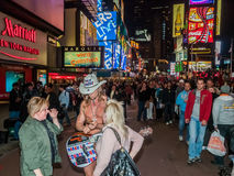 Times Square NYC. At night with 'Naked Cowboy Royalty Free Stock Images