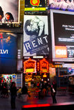 Times Square, NYC, Rent (Musical) Billboard. The billboard for the Broadway play Rent on display in Times Square, NYC royalty free stock photography