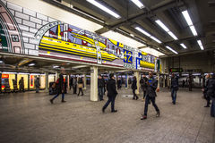 Times Square NYC Subway. NEW YORK CITY - JAN 31, 2014:  View of Times Square subway station in midtown Manhattan with travelers visible. New York City Subway is Royalty Free Stock Images