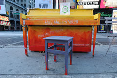 Times Square Piano. A public piano placed in famous Times Square in New York City. Part of the 'Play me I'm Yours' project royalty free stock photos