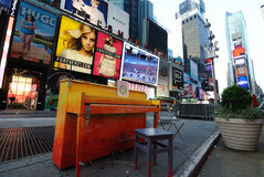 Times Square Piano. A public piano placed in famous Times Square in New York City. Part of the 'Play me I'm Yours' project royalty free stock image