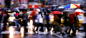 Times Square Rain Panorama. Pedestrians with umbrellas cross the street in Times Square, New York City, USA in the rain stock photos