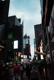 Times Square on rainy day, foggy outside. And a lot of people on streets royalty free stock image