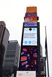 Times Square showing advertisements. NEW YORK, NY - May 7th, 2016: Times Square buildings showing advertisements from Xinhua News Agency, Samsung, Coca-Cola, and stock image