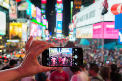 In Times Square with smartphone Royalty Free Stock Photos