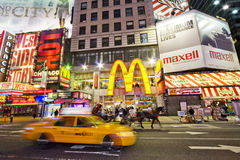 Times Square in New York. Illuminated billboards in Times Square with a yellow taxi in the foreground, New York, U.S.A Royalty Free Stock Photo