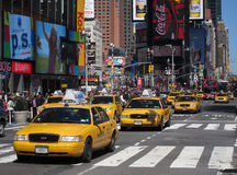 Times Square taxis. Yellow NYC taxis on Times Square, New York City royalty free stock photo