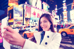 Times Square tourist taking selfie with tablet app Royalty Free Stock Image