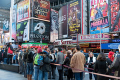 Times Squares - billboards and tourist. Tourist waiting online to buy tickets for broadway shows in times square - 42 street Stock Photos