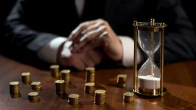 Free Times Up In Hourglass, Businessman Counts Financial Losses After Investment Royalty Free Stock Images - 125997349