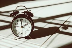Times vintage clock in shade light and shadow art still life. Photography stock photos