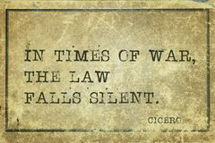 Times of war Cicero. In times of war, the law falls silent - ancient Roman philosopher Cicero quote printed on grunge vintage cardboard Stock Photo