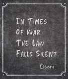 Times of war Cicero quote. In times of war, the law falls silent - ancient Roman philosopher Cicero quote written on framed chalkboard royalty free stock image