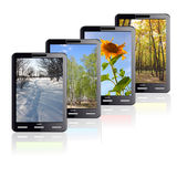 Times of the year. Vertical Tablet computer isolated on the white background. Four different colors stand one by one. Times of the year Stock Photos