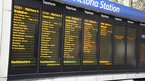 Timetable in Victoria Railway Station, London stock footage