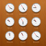 Timezone clocks showing different time, wooden Stock Photos