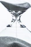 Timglas på en vit bakgrund Fotografering för Bildbyråer