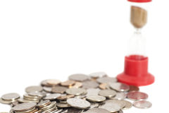 Timglas på mynt Royaltyfri Fotografi