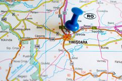 TimiÈ™oara on map. Close up shot of TimiÈ™oara on map with blue push pin stock photography