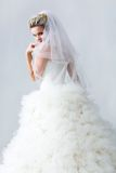 Timid fiancee. Portrait of beautiful timid fiancee in white nuptial dress Stock Images