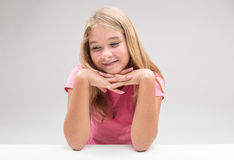 Timid girl daydreaaming or thinking positive Stock Photo