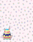 Timid Gray Bunny on Easter Egg background Stock Image