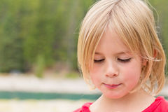 Timid Little Girl Looking Down Royalty Free Stock Image