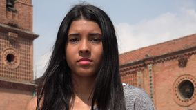 Timid Teen Shy Girl. A young female hispanic teen stock photo