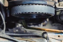 The timing belt on the car. Timing belt on an old car close up stock photo