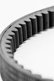 Timing belt for motorcycle engine white royalty free stock photography