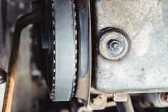 The timing belt on the car. Timing belt on an old car close up stock images