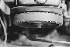 The timing belt on the car. Timing belt on an old car close up royalty free stock photos