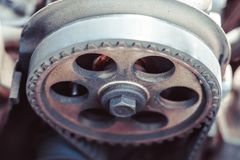 The timing belt on the car. Timing belt on an old car close up royalty free stock image