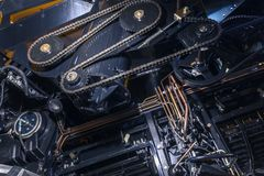 Timing chain of an industrial mechanism. Close up photo stock images