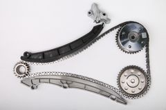 Timing chain kit and timing chain tensioner. The gears and chain of system of gas distribution mechanism on white background. working view of the system of gas stock photography
